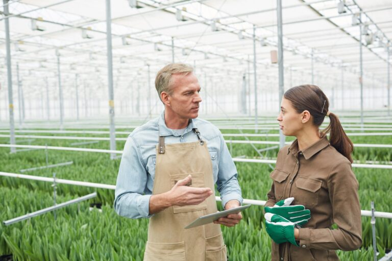 Two Workers Talking in Plantation - Agribusiness Recruiting - Agricultural Appointments